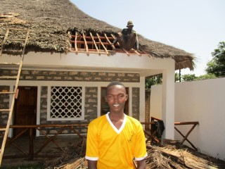 Makuti men fix roofing