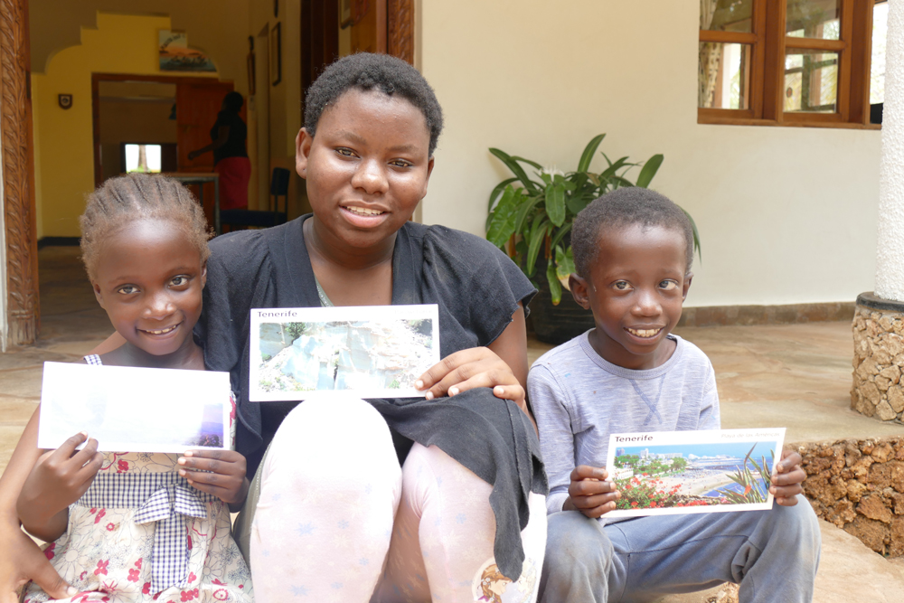 Charity Mariam and Said with  postcards from a member of their sponsor family resize